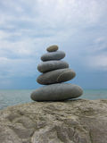 The pyramid of five stones on a rock Stock Photo