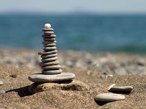 Pyramid of flat pebbles Stock Photography