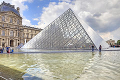 Pyramid and fountain near Louvre Stock Image