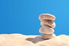Pyramid of four stones. On sand Stock Photo