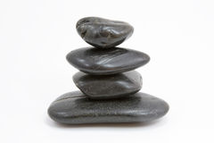 Pyramid of four stones. On a white background Royalty Free Stock Images