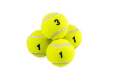 Pyramid of the four tennis balls Stock Photos