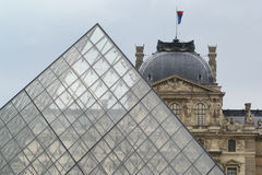 Pyramid in front of the Louvre in Paris. Parisian landmark of glass pyramid with the art museum Louvre in the background Royalty Free Stock Photos
