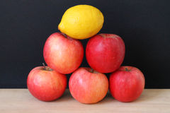 Pyramid of fruit. Pyramid of apples and lemon Royalty Free Stock Photos