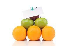 Pyramid of fruits with notes Royalty Free Stock Photo