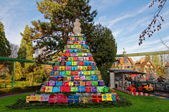 Pyramid of gifts in park at Christmas. A shower of gifts towered at a kids ride with a snowman on the top. Decoration in Europa Park Rust, Germany, in Christmas Royalty Free Stock Photography