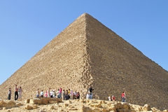 Pyramid Giza. GIZA, EGYPT - FEBRUARY 27: Great Pyramid With Tourists in Giza on FEBRUARY 27, 2010. Crowd of Tourists in Front of Great Pyramid in Giza, Egypt royalty free stock photos