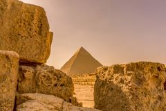 Pyramid in Giza framed between limestone blocks Royalty Free Stock Photo