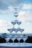 Pyramid of glasses on a background of blue sky Stock Images
