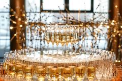 Pyramid of glasses with champagne or white wine at the event catering.  royalty free stock photo