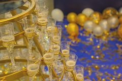 Pyramid from glasses of champagne yellow color. Wedding ceremony stock image