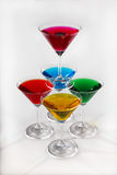 Pyramid from glasses with colored drinks Stock Photos