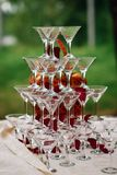 Pyramid of glasses for Martini and champagne for a festive reception Stock Photo