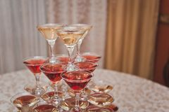 Pyramid of glasses of wine and champagne 6171. Royalty Free Stock Photos