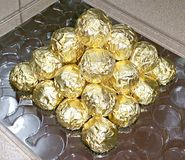 A pyramid of golden foil wrappers Royalty Free Stock Photos