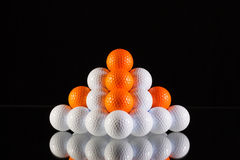 Pyramid of golf balls Stock Photo