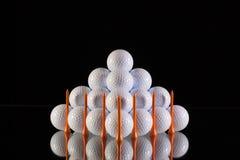 Pyramid of golf balls Royalty Free Stock Images