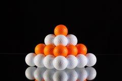 Pyramid of golf balls Stock Images