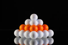 Pyramid of golf balls Royalty Free Stock Photo
