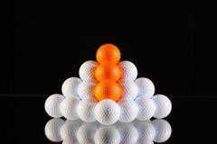 Pyramid of golf balls Royalty Free Stock Image