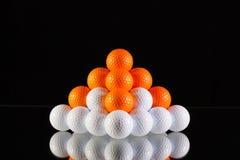 Pyramid of golf balls Royalty Free Stock Photography