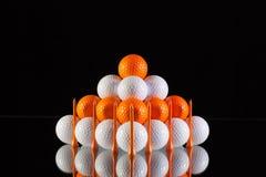 Pyramid of golf balls Stock Photos