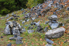 Pyramid of granite stones in the park Royalty Free Stock Photography