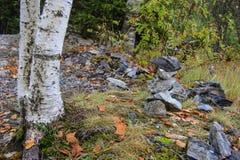 Pyramid of granite stones in the park Stock Photo