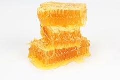 Pyramid of honeycomb on white background