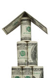 Pyramid of hundred dollar bills with a roof. On a white background Stock Image
