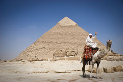 The Pyramid of Khafrae. Cairo - July 2009 - Tourism A man who rents camels to tourists and visitors of the Giza Pyramids site, in front of The Pyramid of Khafrae Royalty Free Stock Photography