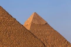 Pyramid of Khafre behind pyramid of Khufu. View on pyramid of Khafre behind pyramid of Khufu Stock Photography