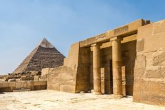The Pyramid of Khafre the Pyramid of Chephren at Giza with the Egyptian temple. The Pyramid of Khafre stands the second tallest among the trio of the Pyramids of stock photo
