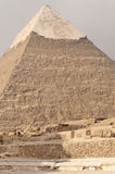Pyramid of Khafre, Egypt. Pyramid of Khafre (Chephren) with its white polished limestone cap still intact at the top.  Giza, Cairo, Egypt Royalty Free Stock Image