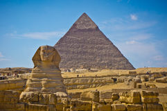 Pyramid of Khafre and Great Sphinx in Giza, Egypt. View of pyramid of Khafre and Great Sphinx in Giza, Egypt Royalty Free Stock Images