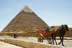 Pyramid of Khafre and horse drawn cart. A horse drawn cart passes the Pyramid of Khafre, Giza, Egypt Royalty Free Stock Photos