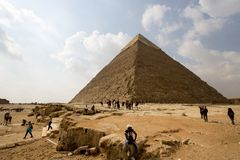 Pyramid of Khufu. Cairo, Egypt – November 12, 2018: photo for Pyramid of Khufu in the Pyramids of Giza in Cairo city capital of Egypt.and Some tourists royalty free stock image
