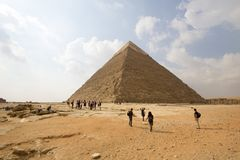 Pyramid of Khufu. Cairo, Egypt – November 12, 2018: photo for Pyramid of Khufu in the Pyramids of Giza in Cairo city capital of Egypt. Some tourists are royalty free stock images