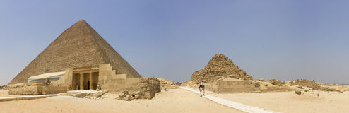 Pyramid of Khufu guarded by a policeman Stock Image