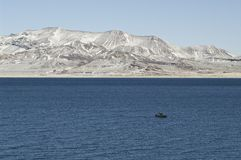 Pyramid Lake Winter scene. Boat on Pyramid Lake in Winter Royalty Free Stock Photo