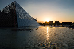 Pyramid of the Louvre. With the arc the tiomphe du carrousel in the background Stock Photo