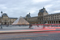 Pyramid of Louvre in the evening Stock Photos