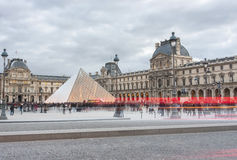 Pyramid of Louvre in the evening Royalty Free Stock Photos