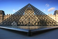 Pyramid of Louvre Museum in Paris France Royalty Free Stock Images