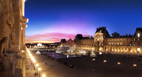 Pyramid of the Louvre Museum in Paris at sunset. Royalty Free Stock Image