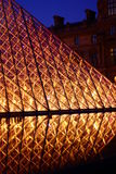 Pyramid of Louvre at night Stock Images