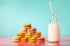 Pyramid of macarons with milk in a bottle Royalty Free Stock Images