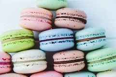 Pyramid of macaroons or macarons close-up. On a desk Stock Photos