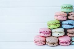 Pyramid of macaroons or macarons on a white wooden background close-up, copy space.  Royalty Free Stock Photography