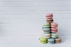 Pyramid of macaroons on a white wooden background. Almond cookies, copy space. Pyramid of macaroons on a white wooden background. Almond cookies, copy space Royalty Free Stock Photo